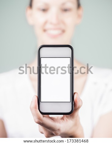 Young woman showing blank smartphone - stock photo
