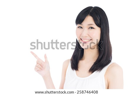 young woman showing copy space, isolated on white background - stock photo
