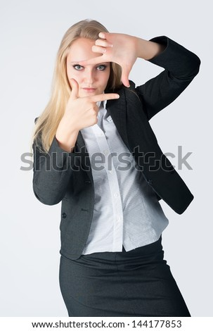 Young woman showing frame by hands on isolated background