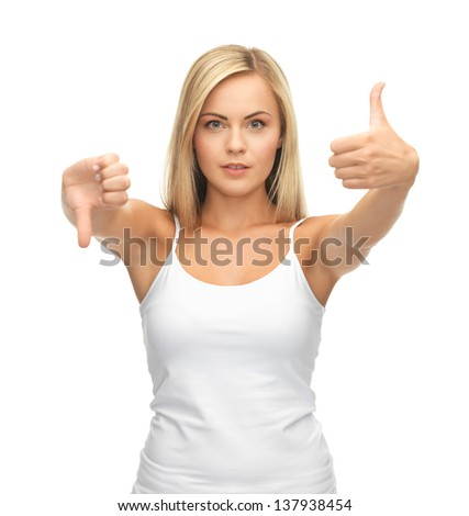 young woman showing good and bad signs - stock photo