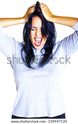 Young woman showing her anger towards someone over a green white background. - stock photo