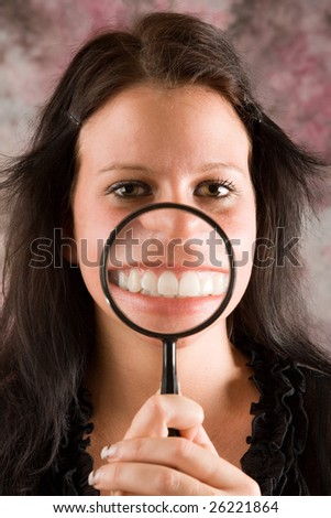 Young woman showing her healthy teeth - stock photo