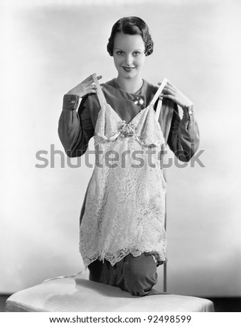 Young woman showing her lingerie - stock photo