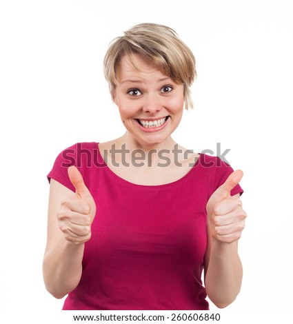 Young woman showing her thumbs up and having a big smile, isolated on white - stock photo
