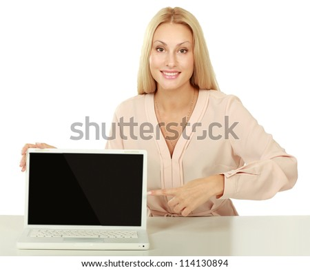 young woman showing laptop with empty space on the screen isolated on white background - stock photo