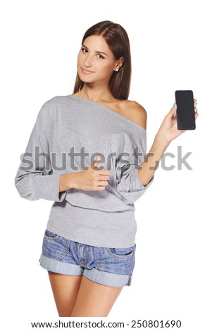 Young woman showing mobile cell phone with black screen and gesturing thumb up, over white background