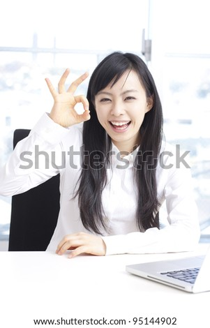 young woman showing OK sign.