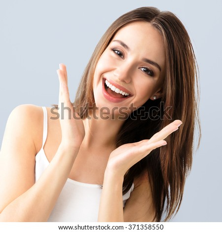 young woman showing smile, in casual smart clothing - stock photo