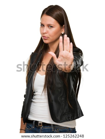 Young Woman Showing Stop Hand Gesture On White Background - stock photo