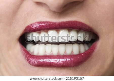 Young woman showing teeth