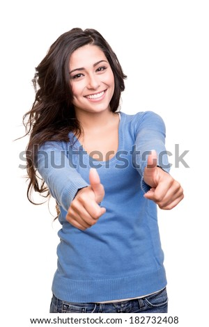 Young woman showing thumbs up over white background - stock photo