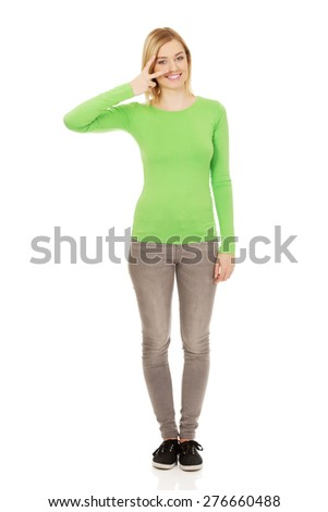 Young woman showing victory gesture. - stock photo