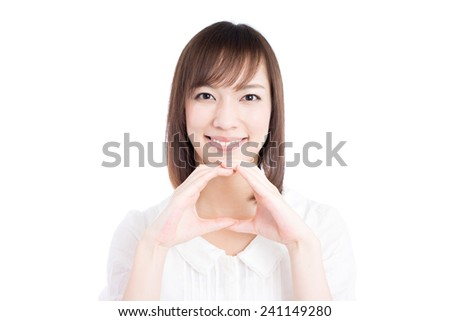 young woman showing yes gesture, isolated on white background  - stock photo