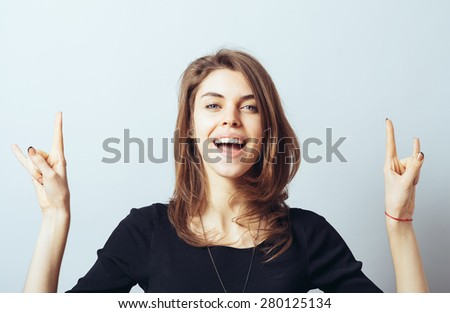 young woman shows a sign of rock - stock photo