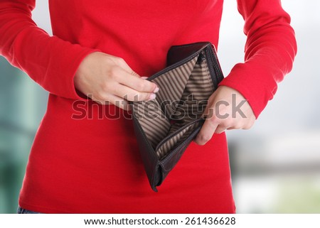 Young woman shows her empty wallet. Bankruptcy - stock photo