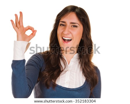 young woman shows sign and symbol ok on white background
