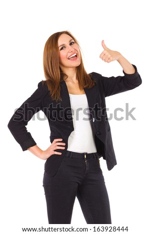 Young woman shows thumb up. Three quarter length studio shot isolated on white. - stock photo