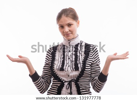 Young woman shrugs - stock photo