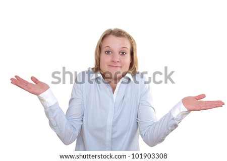 Young woman shrugs her shoulders in a clueless gesture - stock photo