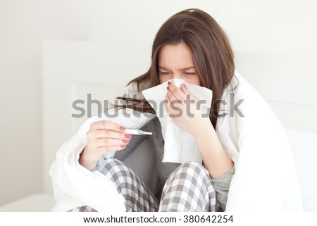 Young woman sick in bed - stock photo