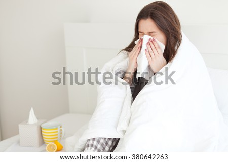 Young woman sick in bed