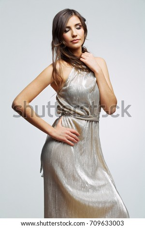 Young woman silver dress wearing. Fashion woman portrait. Female young model. Isolated.