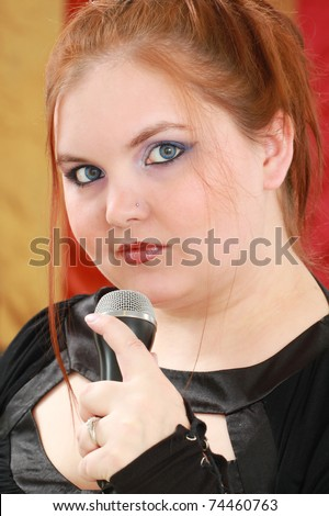 Young woman singing - stock photo