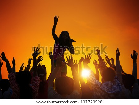 Young Woman Singing in Front of the Audience - stock photo