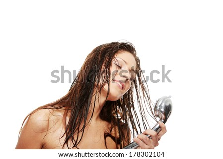 Young woman singing under shower, isolated on white