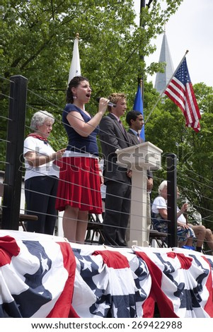 """Young woman sings """"God Bless America"""" during Memorial Day, 2011 Ceremonies, Concord, MA - stock photo"""