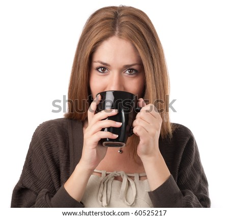 Young woman sipping from a cup,isolated on white
