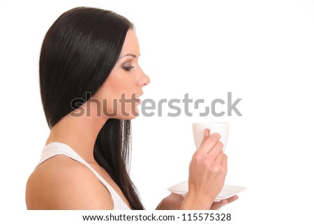Young woman sipping tea from a cup - stock photo
