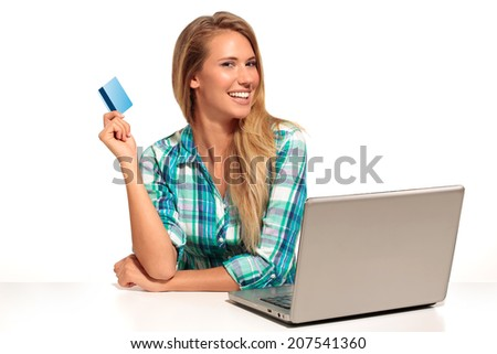 Young Woman Sitting at the desk  shopping Online on white - stock photo