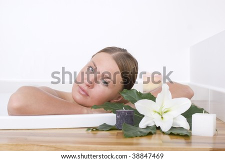Young woman sitting in a bath - stock photo