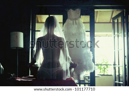 young woman sitting in a veil from the back of the form