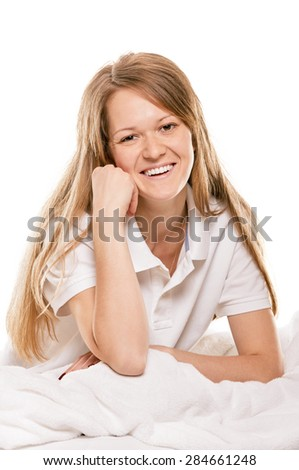 young woman sitting in bedroom at early morning, on white background
