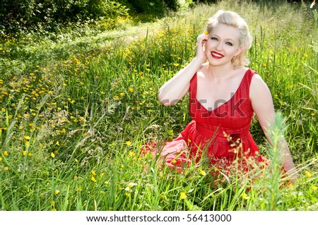 young woman sitting in field of wildflowers