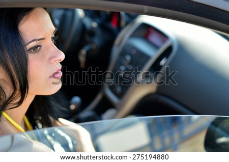 young woman sitting in the car