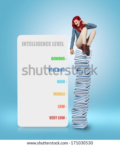 young woman sitting on a books tower measuring her intelligence level - stock photo