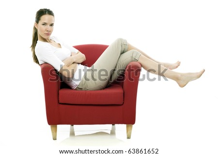 Young woman sitting on a chair on white background studio
