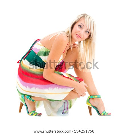 Young woman sitting on a floor isolated on white background