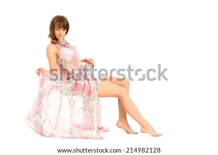 Young woman sitting on a white vintage shabby chair, legs crossed