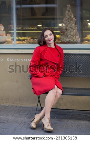 Young woman sitting on bench and feel relaxed  - stock photo