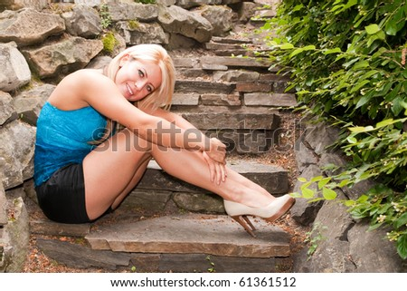 Young Woman Sitting on Stone Steps