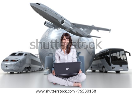 Young woman sitting on the floor with a laptop with an international tourism background - stock photo