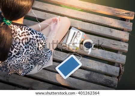 Carpenter Holding Digital Tablet Workbench Stock Photo