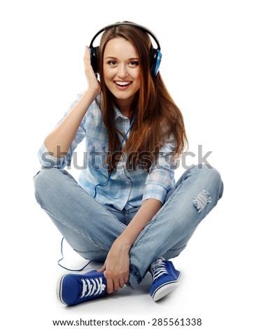 Young woman sitting with headphones isolated on white