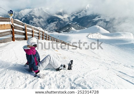 Young woman skier against a wonderful winter mountains background - stock photo