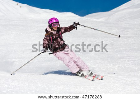 Young woman skiing fast on the slope. Winter vacation