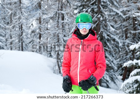 Young woman skiing in the Alps